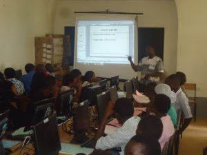Kal training community members in ICT. Students could support such training programs too.